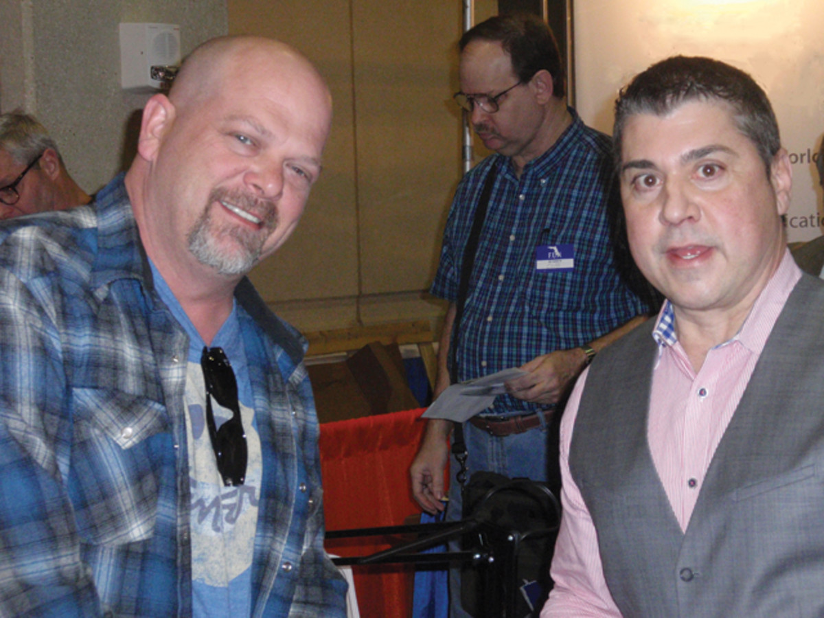Pawn Star Rick Harrison talks to Fred Bart at the NGC booth at the FUN convention.