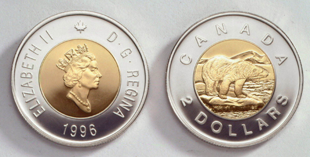 Obverse and reverse of Canada's first circulating $2 coin: 28 mm across, 1.8 mm thick, 7.3 g; outer nickel ring about aluminum-bronze core, KM-270. The obverse effigy of Queen Elizabeth II is by designer Dora de Pédery-Hunt. The Polar Bear reverse design is the work of Brent Townsend. Images courtesy RCM.