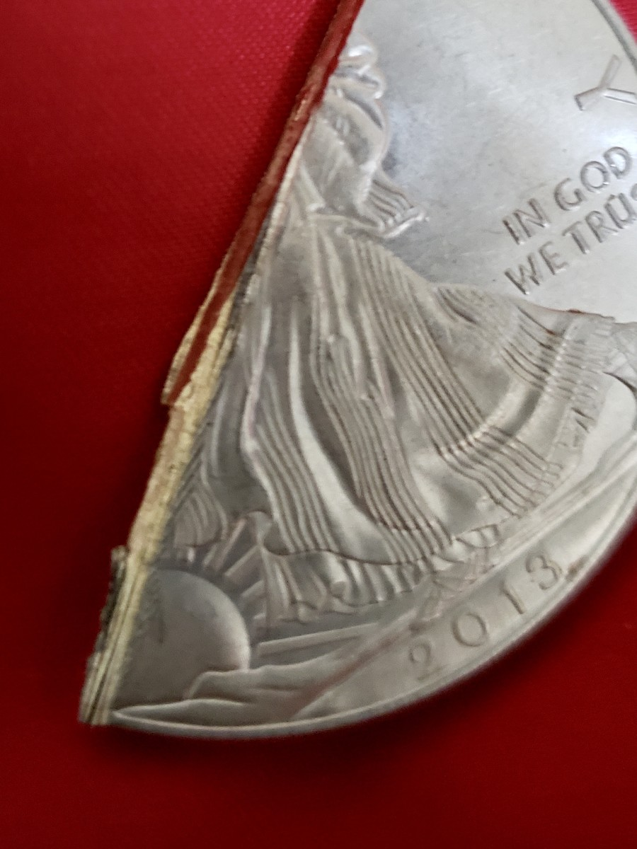 Cutting in half one of the 10 counterfeit silver American Eagles revealed it was composed of base metal. (Image courtesy of fraud victim.)