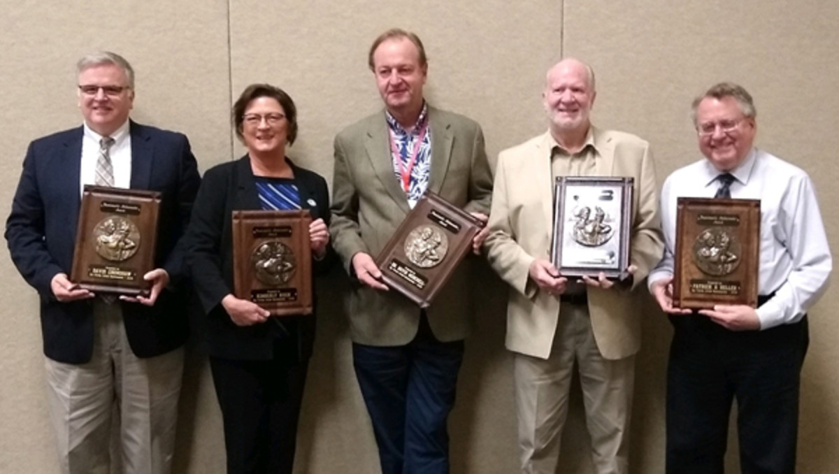Accepting plaques for 2020 Numismatic Ambassador honors are (from left) David Crenshaw, Kim Kiick, Mark Anderson accepting on behalf of David Menchell, Scott E. Douglas and Patrick A. Heller. (Photo courtesy Dave Harper.)