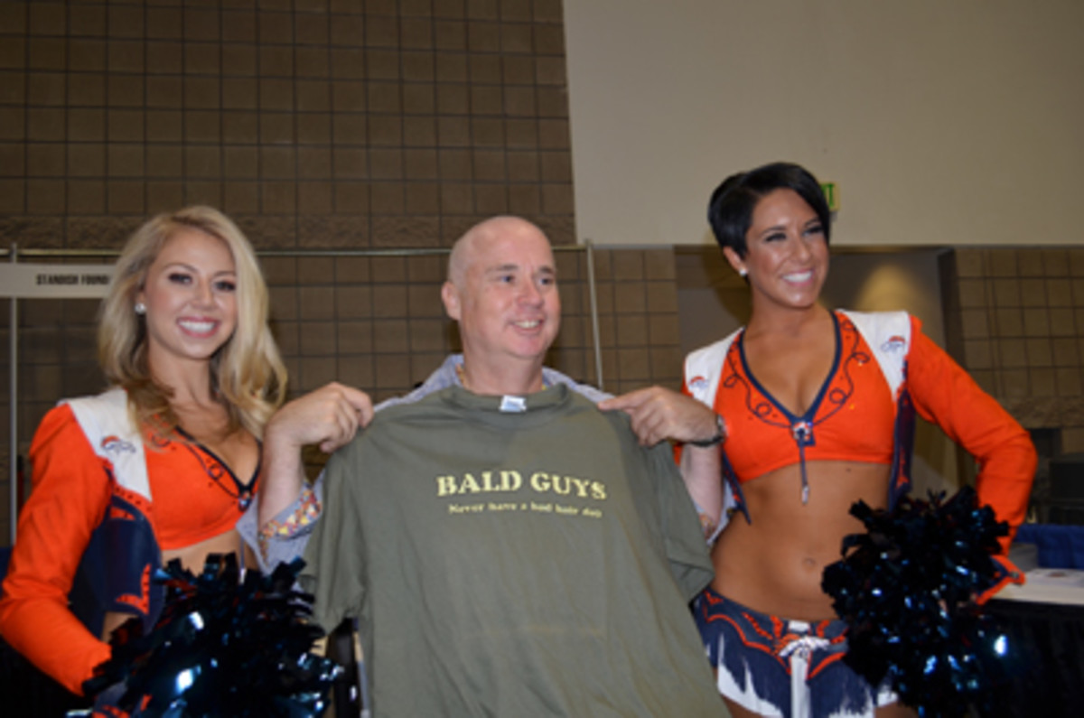 Cheerleaders Krista and Brielle with Miles and his t-shirt. (Donn Pearlman photo)