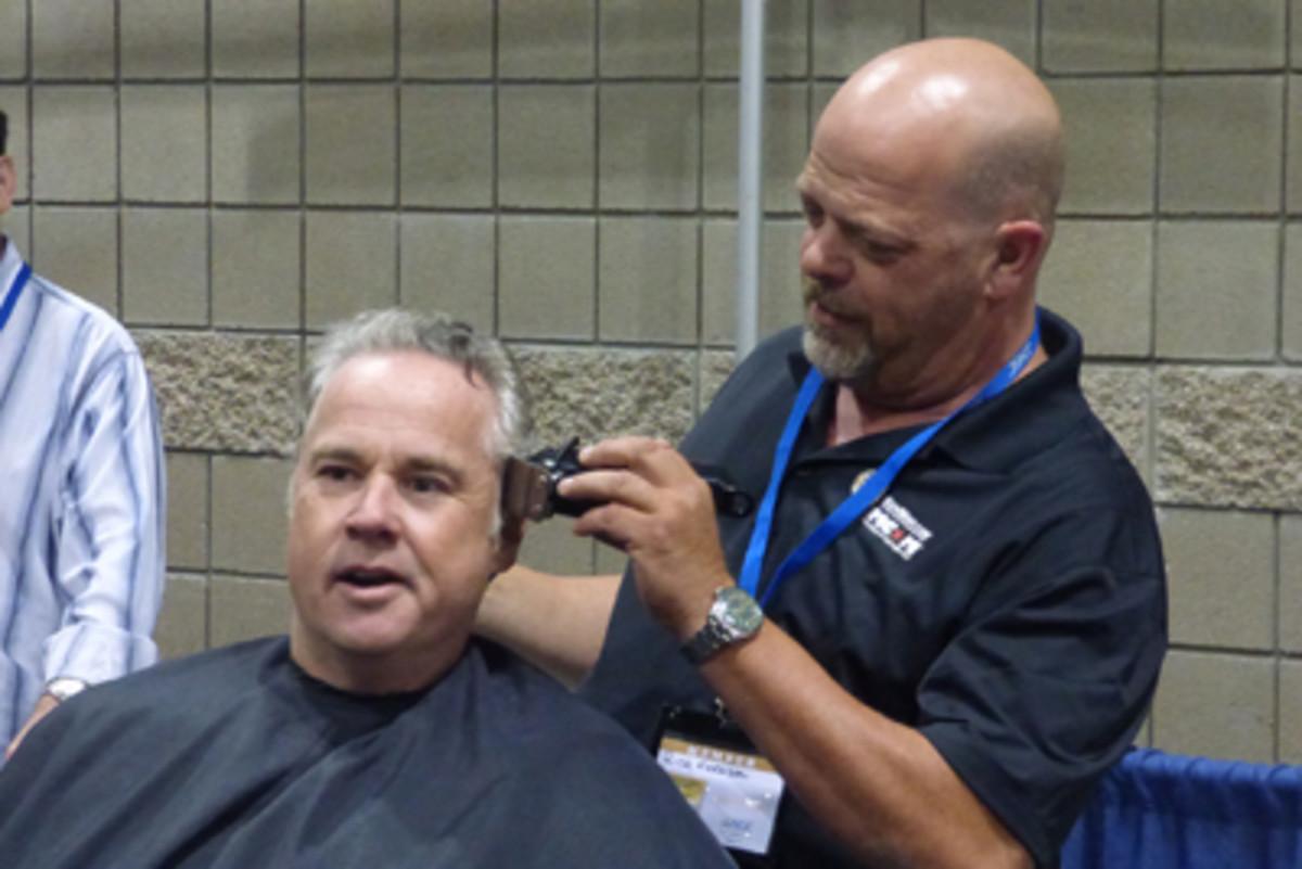 Pawn star Rick Harrison takes over the head shaving task.