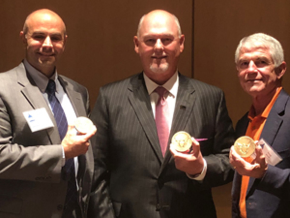 Homeland Security Investigations Special Agent Nicholas L. Tranchitella, Delaware Valley Rare Coins President Richard Weaver, and NCIC President Doug Davis were awarded ACTF's 2018 Al Kreuzer Memorial Award for outstanding work in combatting counterfeiters and those who traffic in counterfeit coins and currency in the United States. (ICTA image by David Crenshaw)