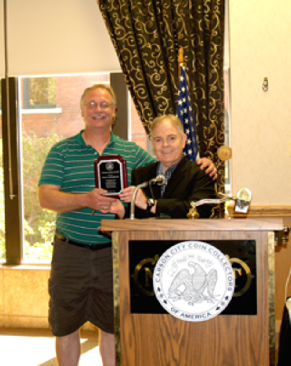C4OA President Rusty Goe gives life member Mark Archambault a club service award plaque for spearheading the 2014 regional meeting.