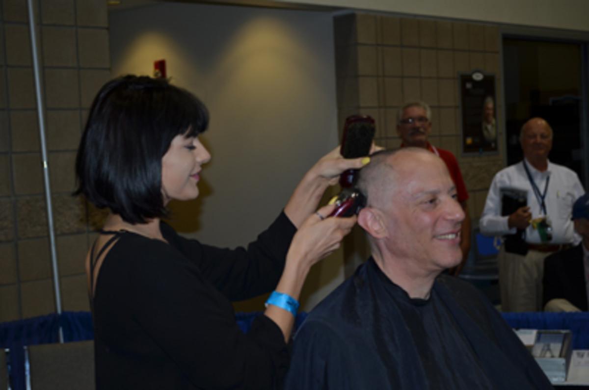 Hair stylist Dava shaves Jim Halperin's head. (Donn Pearlman photo)