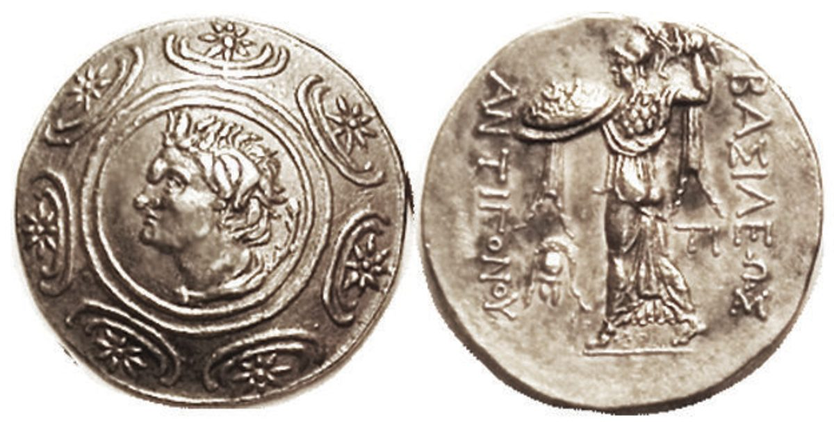 "taken from site) ""Antigonos Gonatas, 277-239 BC, Tet., Pan head in shield/ Athena Alkidemos stg l, helmet in field, TI at rt; Choice EF, well centered & struck, good metal with lt tone, unusually nice example with strong detail. Scarcer variety. (Same variety, EFs, brought $9102, Lanz 6/11 & $6759, NAC 5/15.) Start Bid $750"""