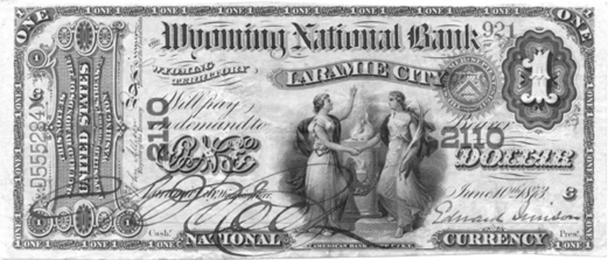 This Original Series $1 Laramie note was printed in 1873, without charter numbers. The unissued sheet containing this note was returned by the Comptroller's office to the BEP so that the charter numbers could be overprinted on the sheet in compliance with the Act of June 20, 1874, that required that the numbers be on National Bank Notes.