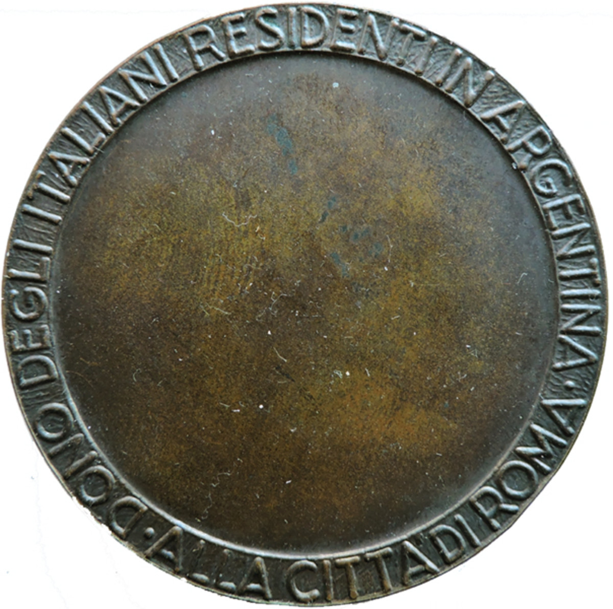 The reverse has DONO DEGLI ITALIANI RESIDENTI IN ARGENTINA ALLA CITTA'DI ROMA on the perimeter. The medal weighs 46.95 gram and has a diameter of 51.12 mm. If I ever finish my reference work on San Martin medals, it will have an attribution.
