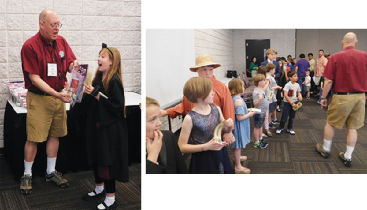Kids line up for goody bags from Bob Hartje. (Photos by Richard Jozefiak)