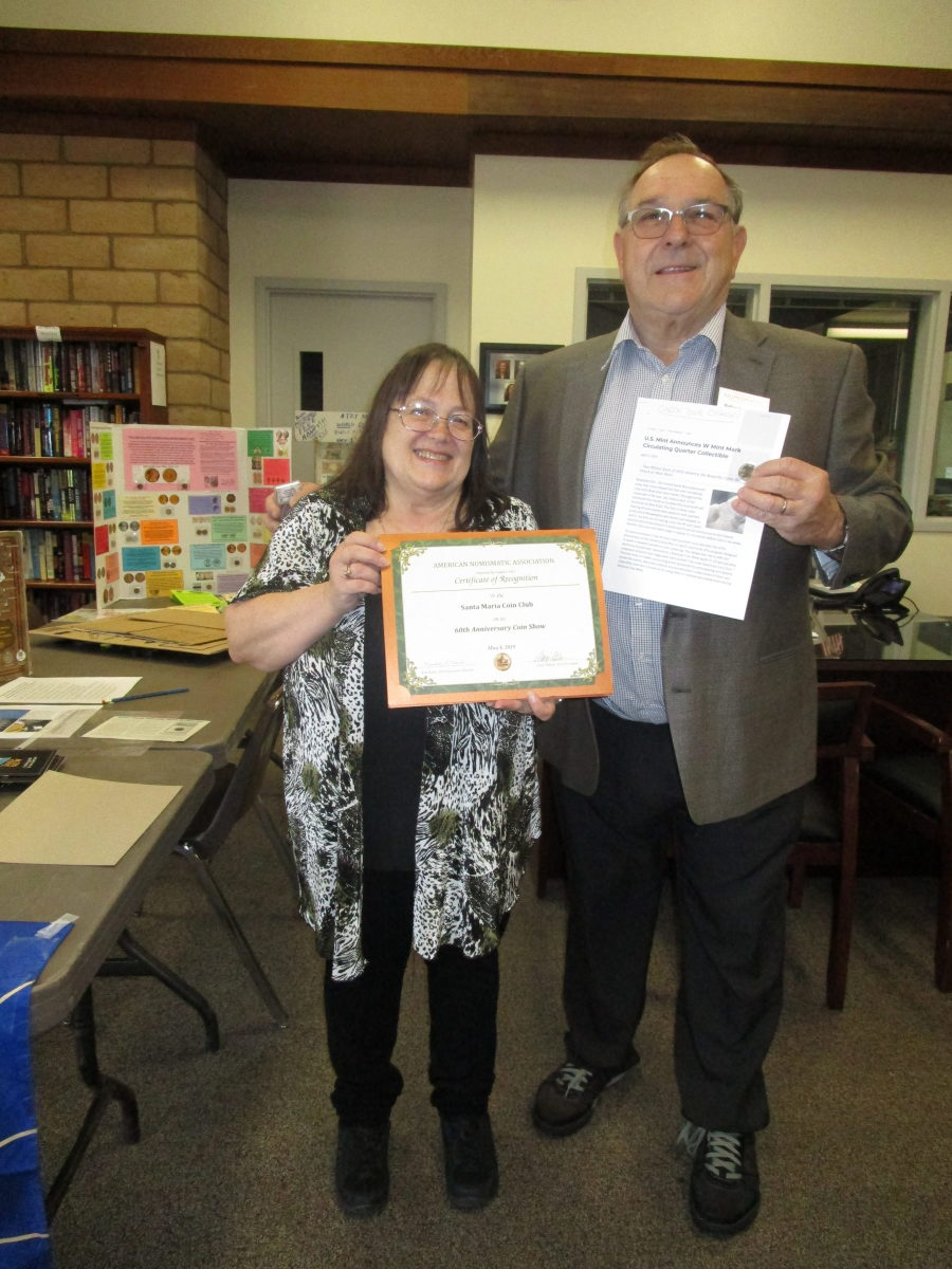 (right) Walt Ostromecki, ANA past president (right), presents Linda Nash, Santa Maria Coin Club president, with an ANA 60th Anniversary Coin Show Certificate of Recognition along with a 2019-W circulation strike America the Beautiful quarter.