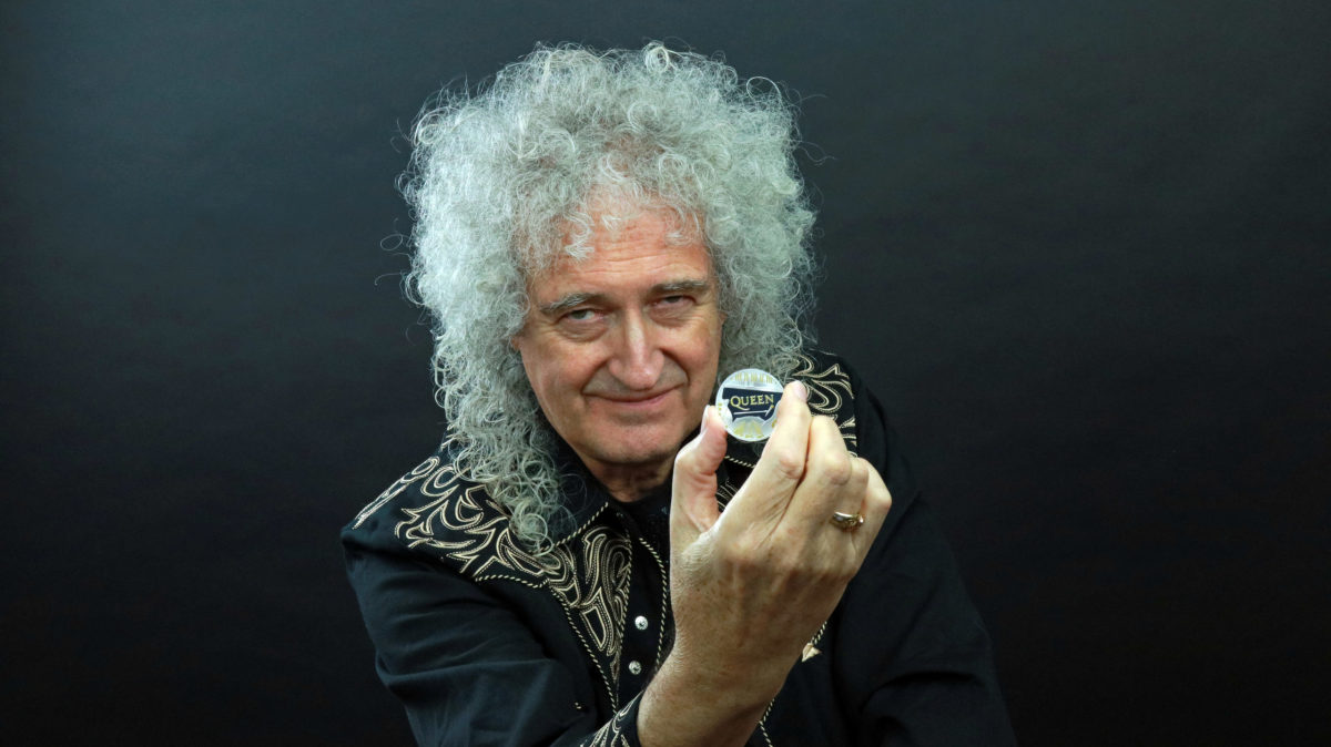 Brian May from Queen with the new coin. Photo courtesy of Queen Productions Ltd.