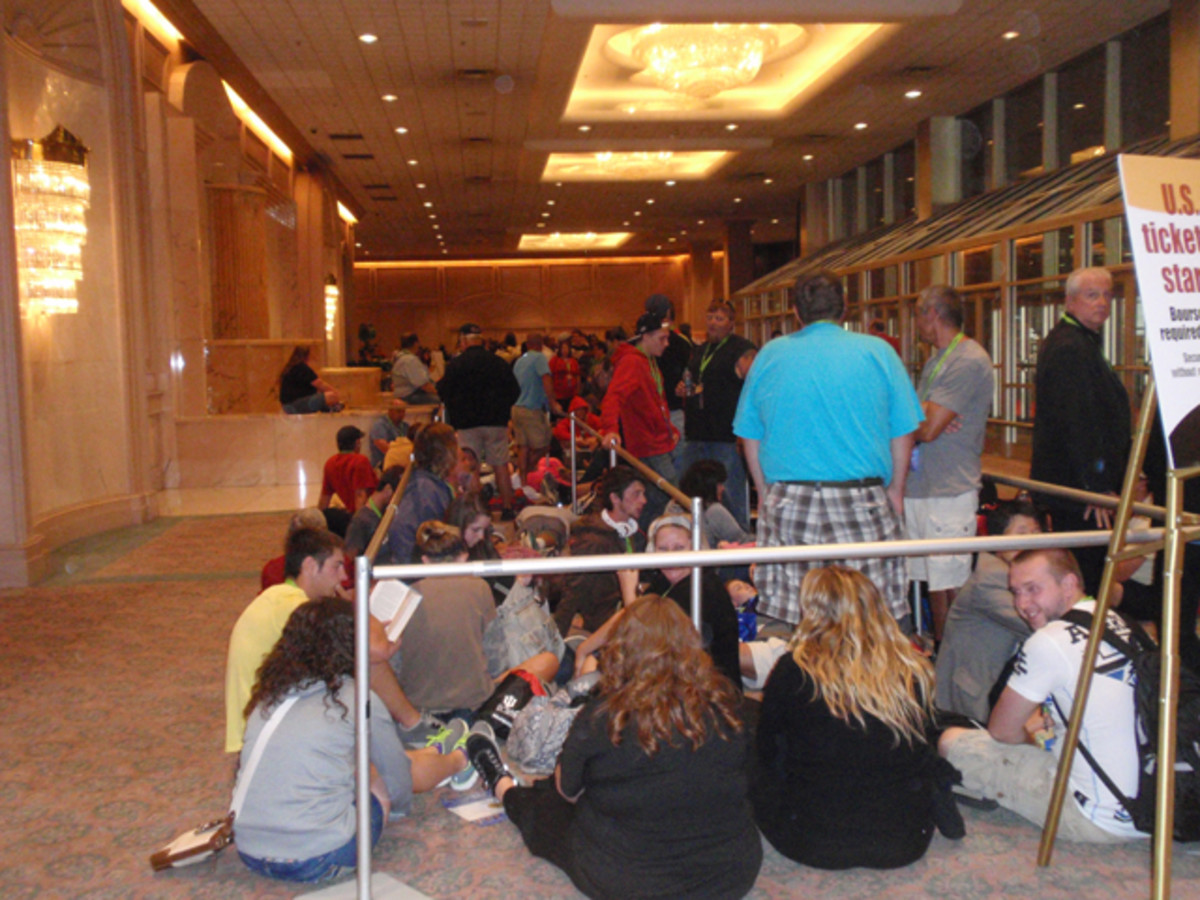 Inside, it looks like a line for airport security as ticket holders wait for a chance to buy gold Kennedy half dollars.