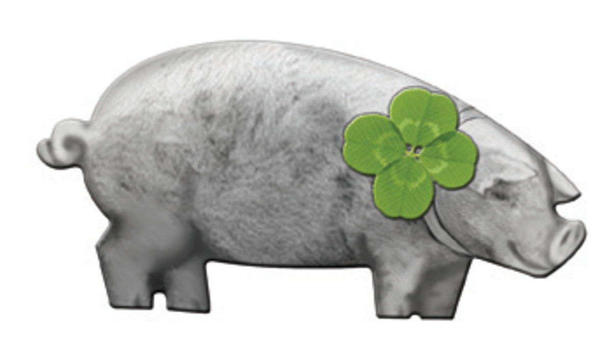 Helvetic Mint's satinated silver Niuean dollar shaped as for a pig and bearing a four-leaf clover. (Image courtesy Helvetic Mint)