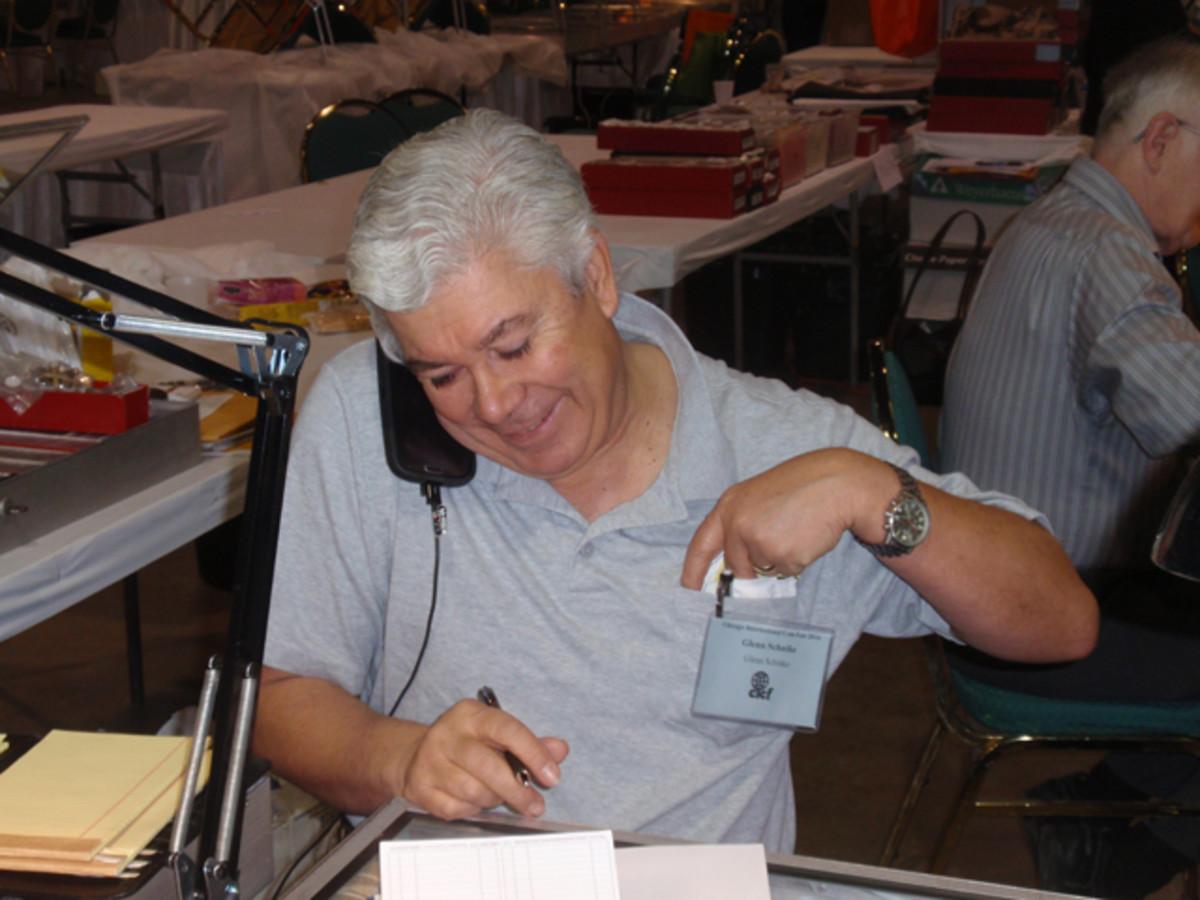 Glenn Schnike multitasking at his booth.