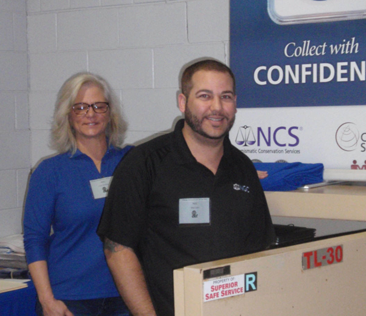 Opening the safe at the NGC table were Lisa Goolsby and Matt Gens.