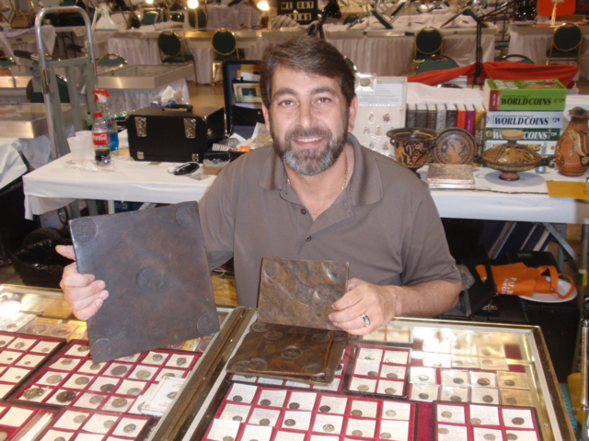 James Beach shows Swedish plate money at his bourse table.