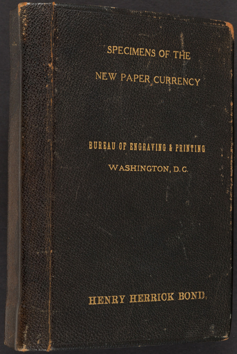 The cover of the leather-bound presentation book, and face and back of the $10,000 and $5,000 Federal Reserve Notes in the specimen set of small-size notes presented to Assistant Treasury Secretary Henry Herrick Bond on his retirement. All of the notes are printed on Crane Co. paper and are wide margin. Each carries serial No. 00000.