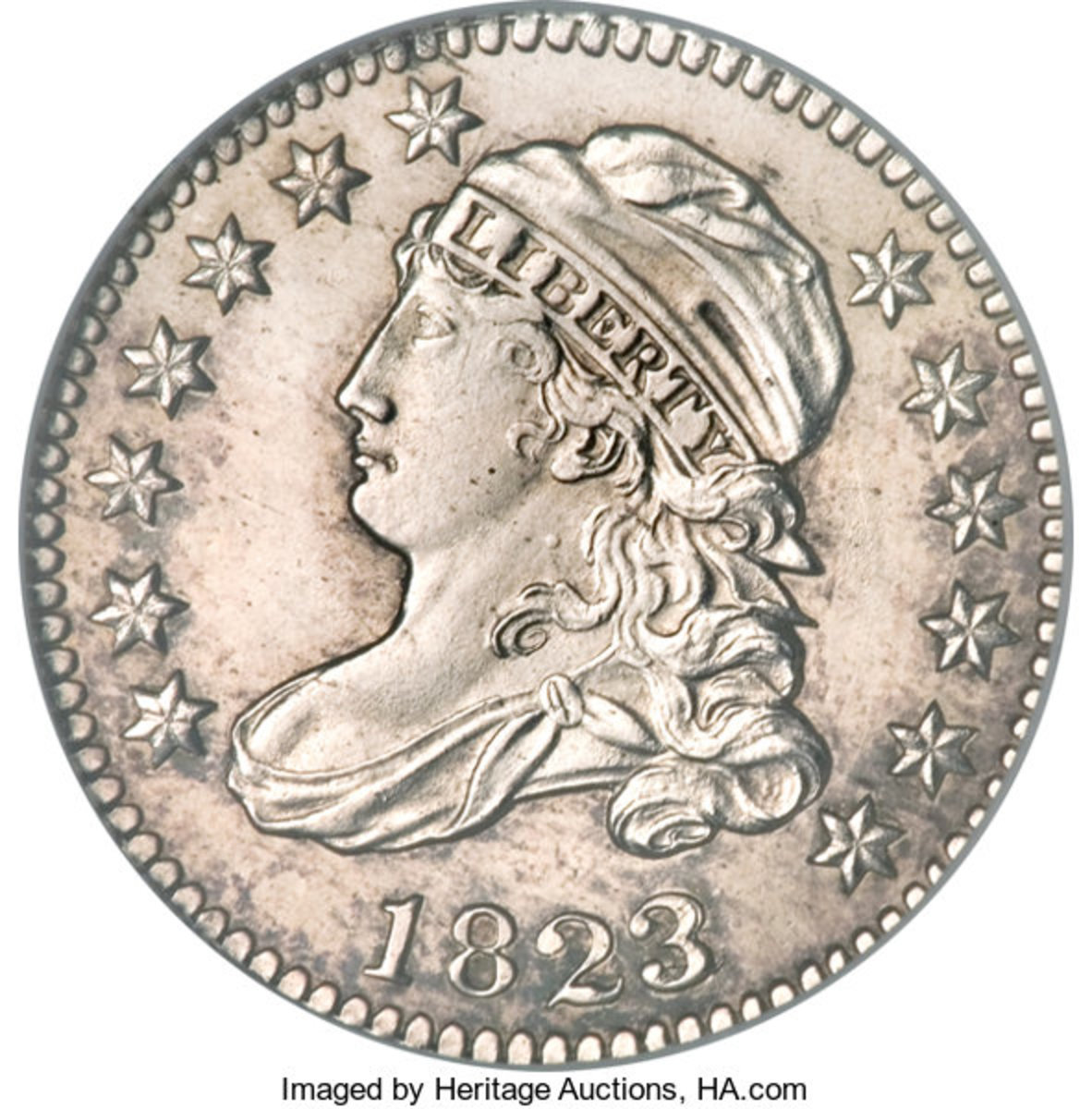 Shown is an 1823 10C Large Es is NGC graded MS66 from the Joseph C. Thomas Collection. (Image courtesy of Heritage Auctions.)