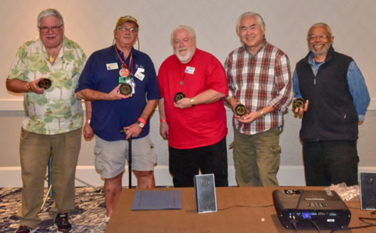 Left To Right, James H. Laird, Michael S. Turrini, Donald L. Hill, Lloyd G. Chan and Herbert Miles, all smiles holding their thank you engraved marble coasters, presented for their contributions toward the Educational Forum at the San Jose, Calif., Coin Club's January 2018 show.