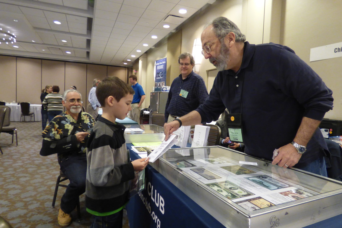 Young and old enjoyed the hunt at CPMC. At right, Steve Zitowsky of the Chicago Coin Club helps Justin Lute, who collects notes with birds on them.