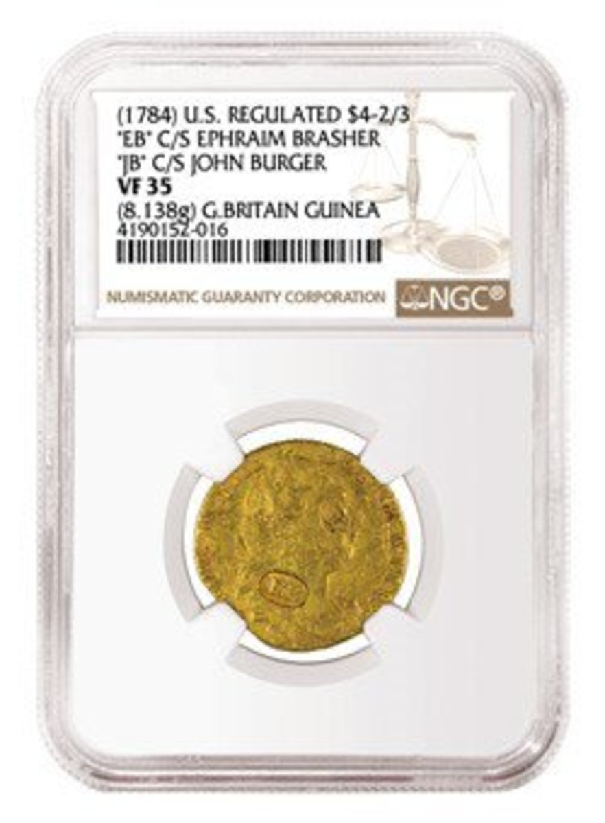 The regulated gold piece Guinea in an NGC slab.