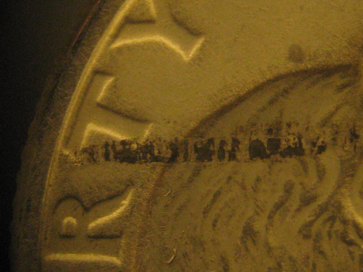 Figure 2: Lesser flaw of the same type on silver quarter.
