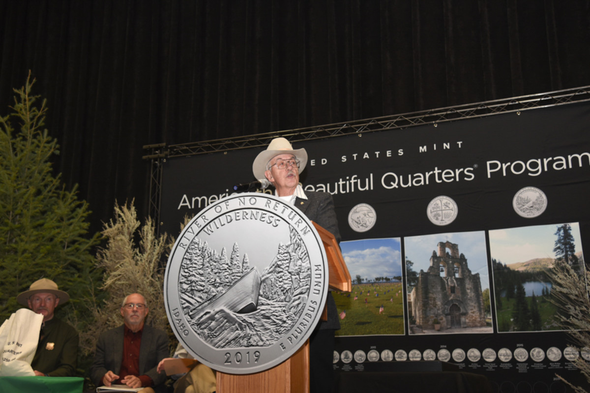 John Burns, former forest supervisor, Salmon National Forest, welcomes attendees and distinguished guests during the launch of the Frank Church River of No Return Wilderness quarter Nov. 6 in Salmon, Idaho. The coin is the 50th release in the Mint's America the Beautiful program. (U.S. Mint photo by Jill Westeyn.)