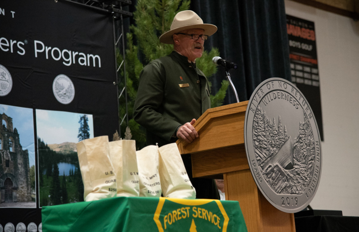 Charles Mark, forest supervisor, Salmon-Challis National Forest, speaks to attendees at the quarter launch ceremony. (U.S. Mint photo by Brian Martin.)