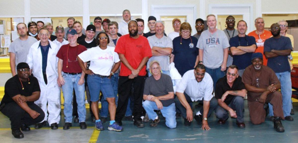 The staff coining division staff in Philadelphia posed for a photo to mark the occasion.