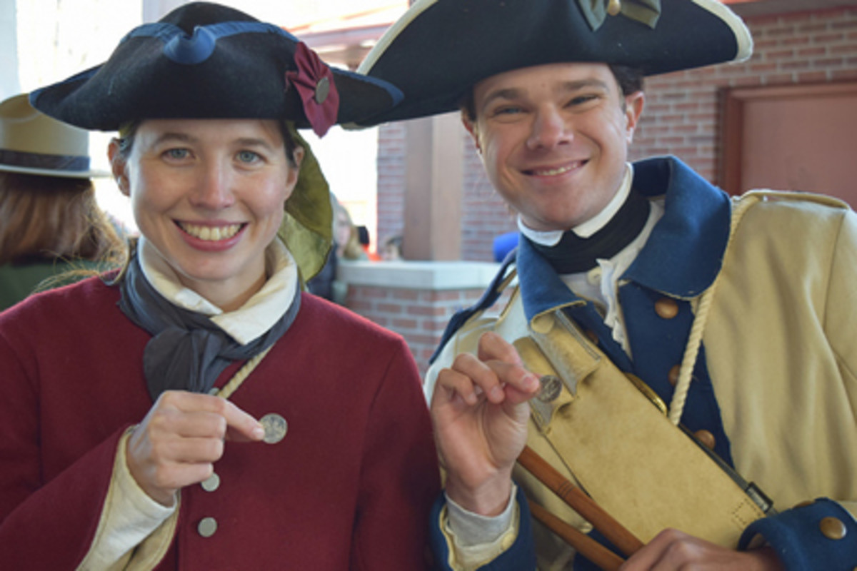 Two members of the George Rogers Clark Fife and Drum group hold up the new quarter. (U.S. Mint photo by Sharon McPike)