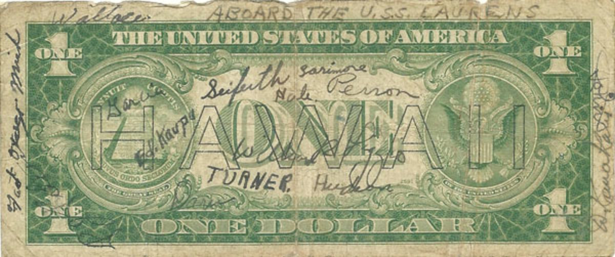 Fig. 1. This Hawaii $1 short snorter bears signatures of buddies heading to or from a beach landing aboard the 'USS Laurens.'