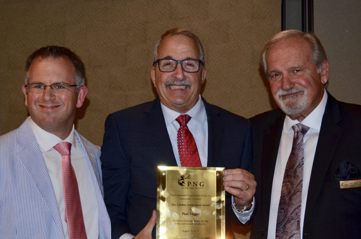 PNG Board member John Brush (left) and Executive Director Robert Brueggeman (right) presented the prestigious PNG Founder's Award to Paul Nugget (center) in 2019.