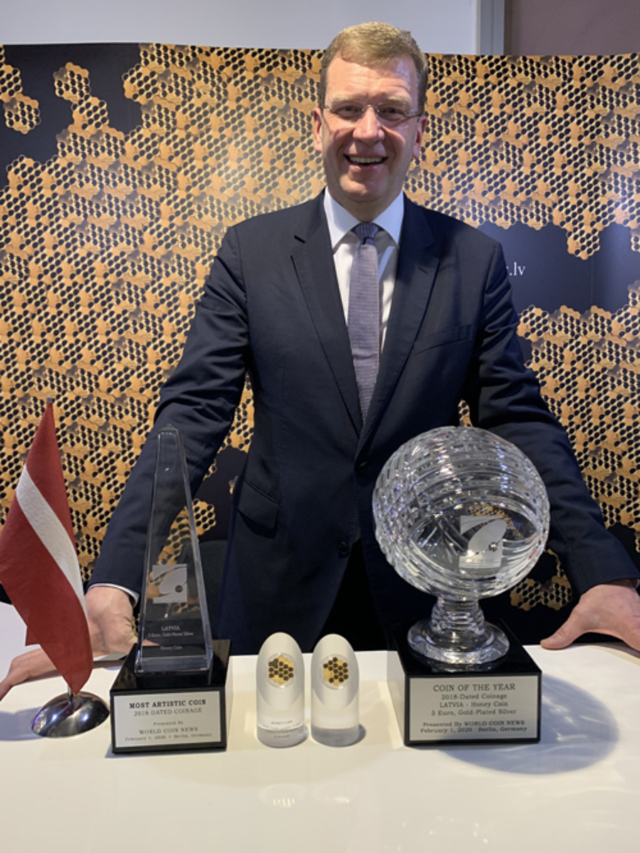 Jānis Blūms of the Bank of Latvia with The Honey Coin and its awards.