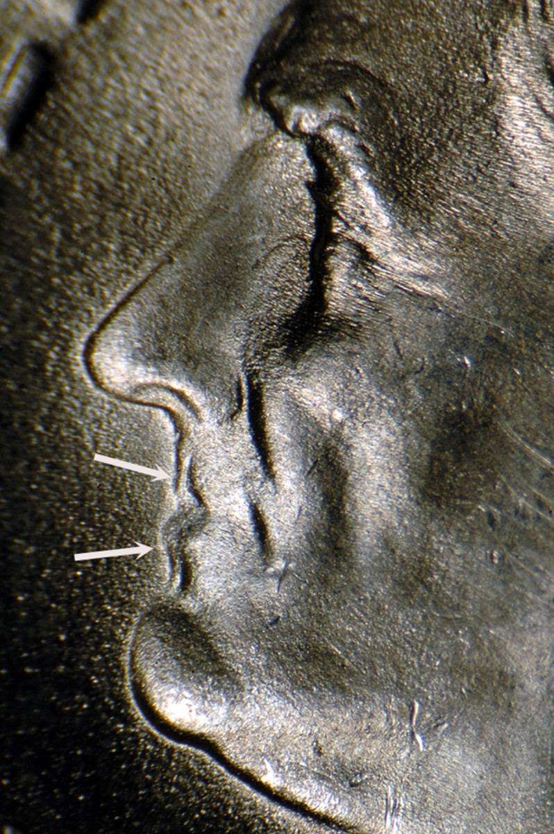 Doubling on a 1953-S Roosevelt dime is strong around the lips.