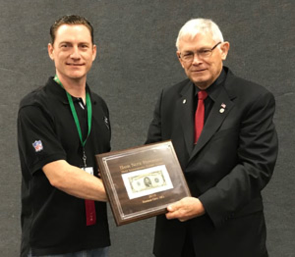 Robert Calderman, left, receiving the 'Bank Note Reporter' Most Inspirational Exhibit Award from Clifford Mishler during IPMS 2018.