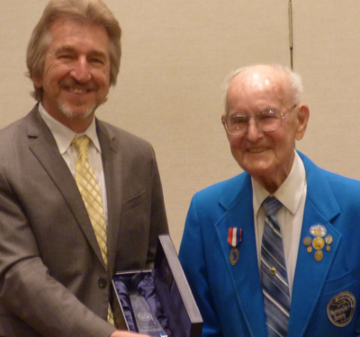 Raymond W. Dillard, right, receives recognition for his induction into the ANA Hall of Fame from Jeff Garrett.