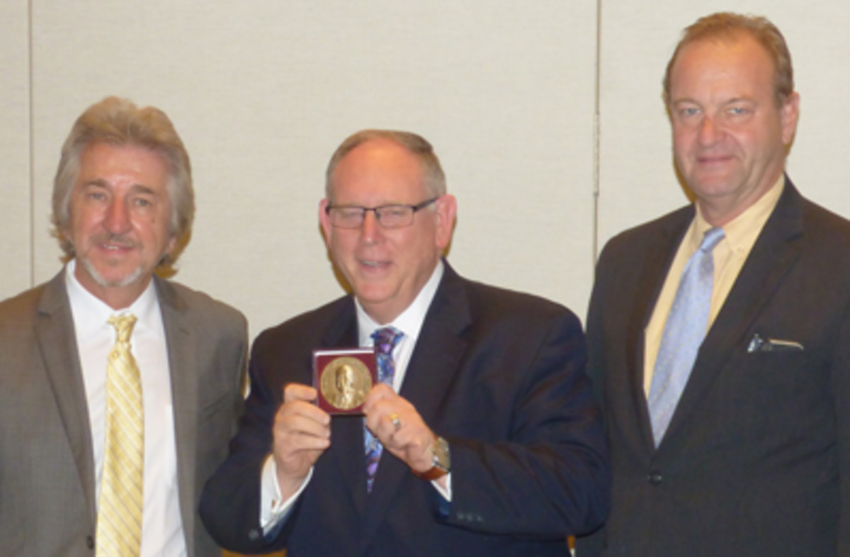 Donn Pearlman, center, displays his Burnett Anderson Memorial Award with Jeff Garret, left, and Mark Anderson.