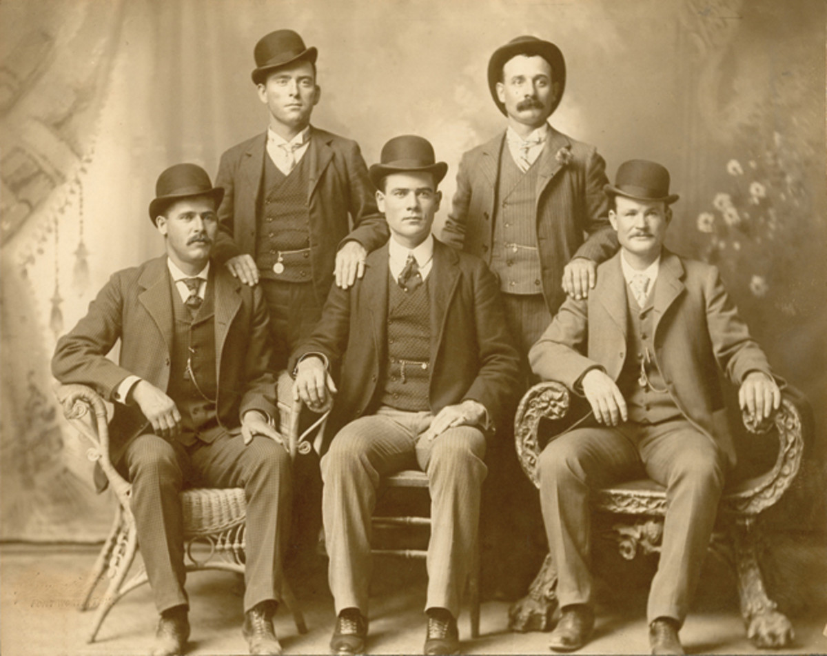 """The iconic image of Butch Cassidy and the Wild Bunch taken at a studio in Fort Worth, Texas in 1900. Shown seated left to right: Harry A. Longabaugh, the """"Sundance Kid""""; Ben Kilpatrick, the """"Tall Texan""""; and Robert Leroy Parker, """"Butch Cassidy."""" Standing left to right: Will Carver, """"News Carver""""; and Harvey Logan, """"Kid Curry."""""""