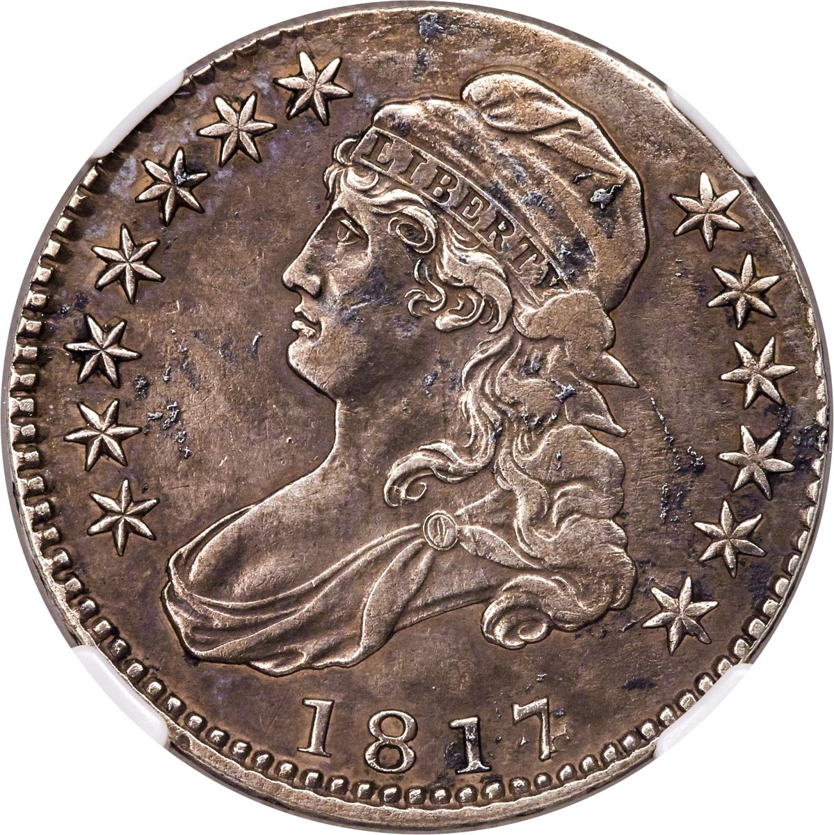 One of the greatest half dollar rarities and key to the Overton Variety Series, this 1817/4 sold for $156,000. (Image courtesy of Heritage Auctions)