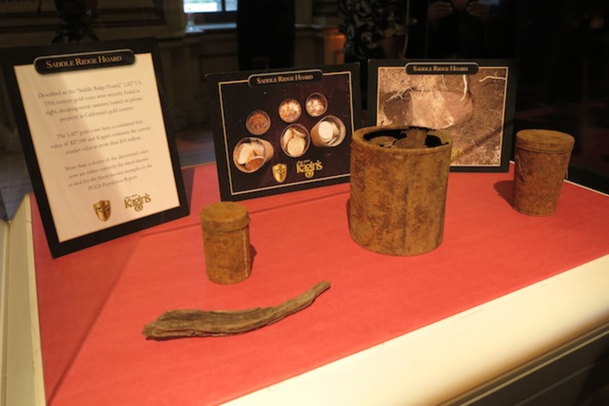 The rusted cans and the stick used to dig them out of the ground were displayed.