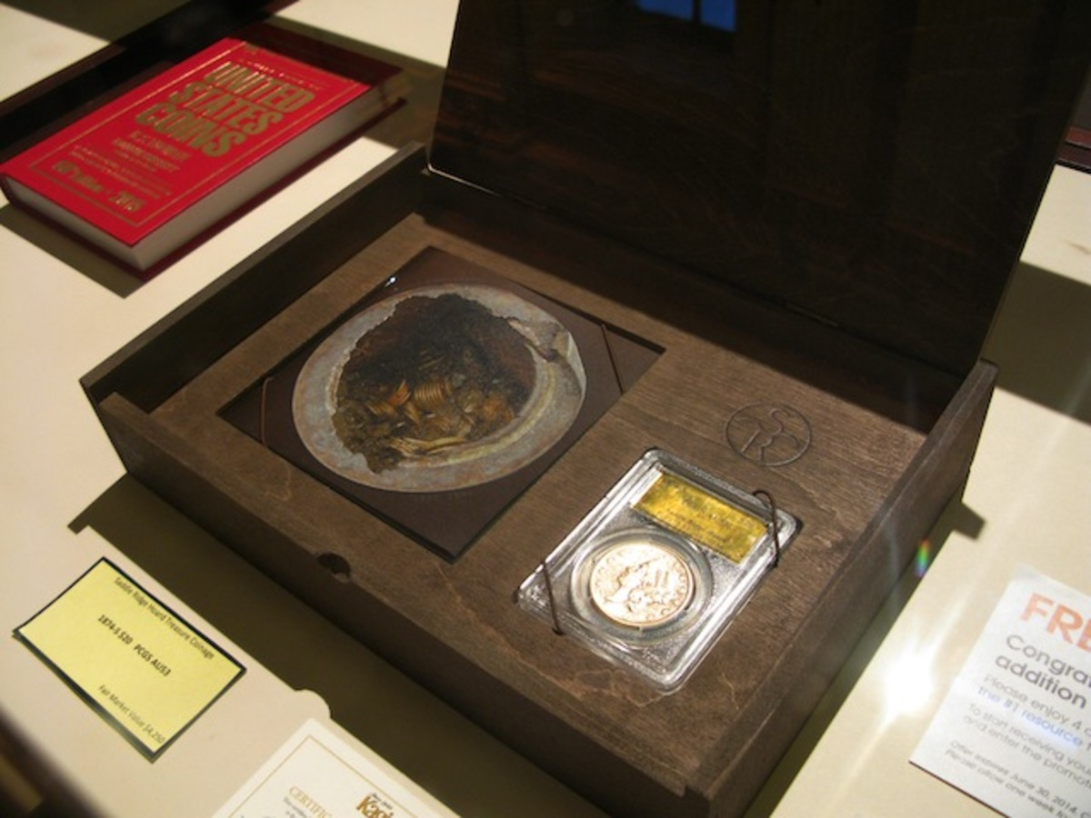 A coin donated by the couple who found the treasure was placed in a presentation box and auctioned for charity.