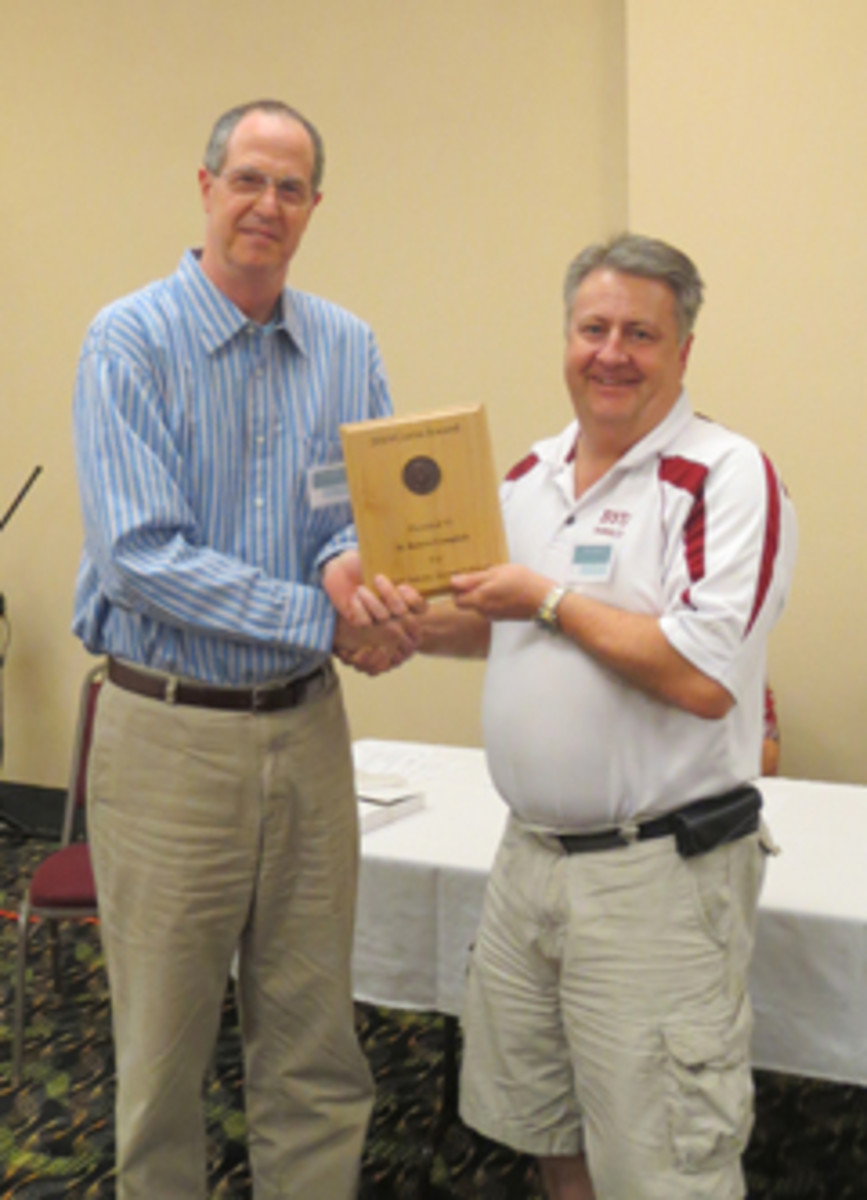 Bob Campbell (right) receives the 2014 James J. Curto Award from Tony Chibbaro on at the National Token Collectors Association  Annual Token Show in Omaha.