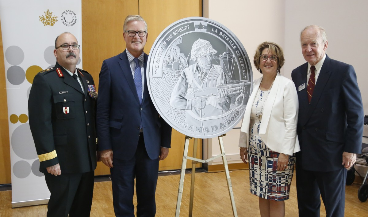 The ceremonial unveiling of the silver $0 proof commemorating the 75th anniversary of the Battle of the Scheldt. From left: Major-General Stephen Whalen, Kingdom of the Netherlands Ambassador Henk van der Zwan, Royal Canadian Mint CEO Marie Lemay and Perley and Rideau Veterans' Health Centre Foundation Chair Keith de Bellefeuille Percy. Image courtesy & © Royal Canadian Mint.