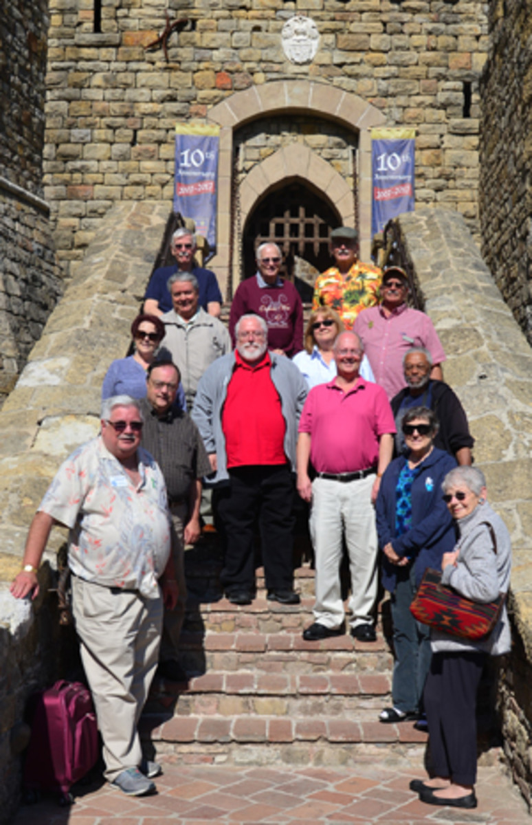 The tour group poses on the steps of Castello di Amorosa, a real castle celebrating its 10th anniversary.