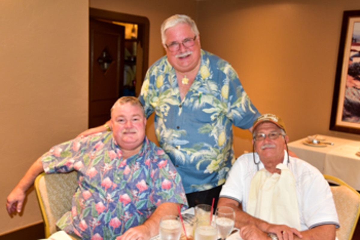 The two benefactors and the seminar coordinator pause for a moment at dinner after the event Sept. 16. Left to right are Xan Chamberlain, James Laird and Stan Turrini