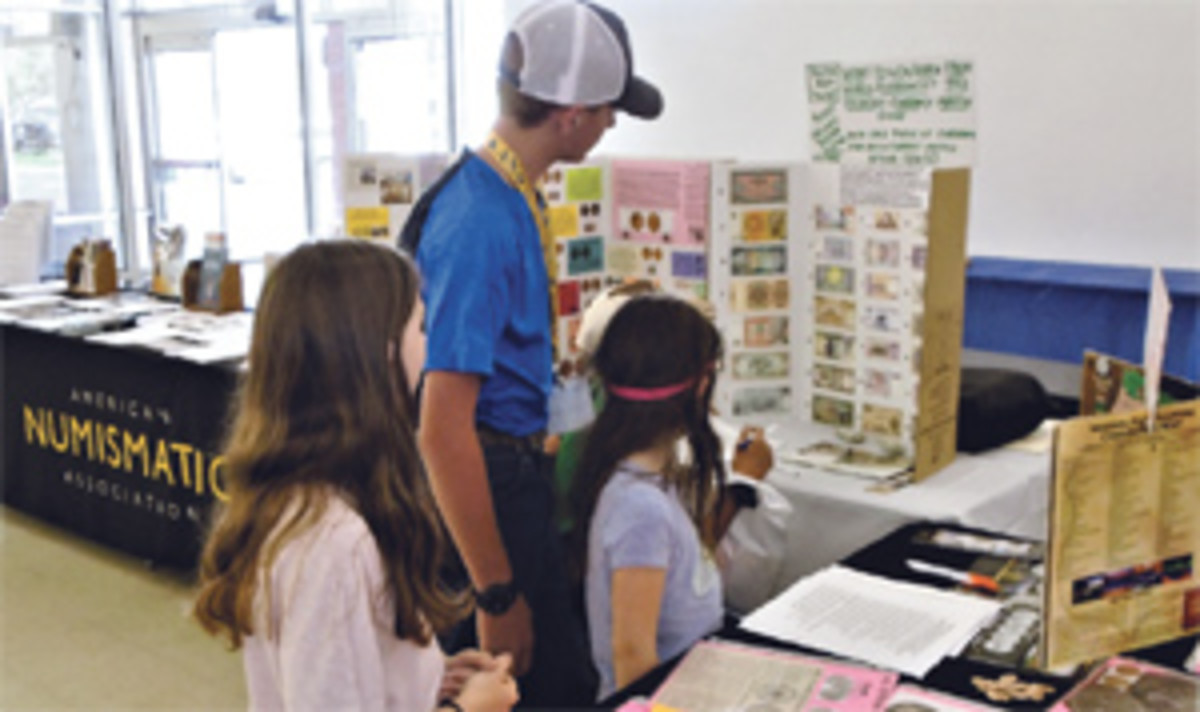 Four Young Numismatists look over ANA Money Display in Kid's Zone at June 2018 Colorado Springs Coin Show.