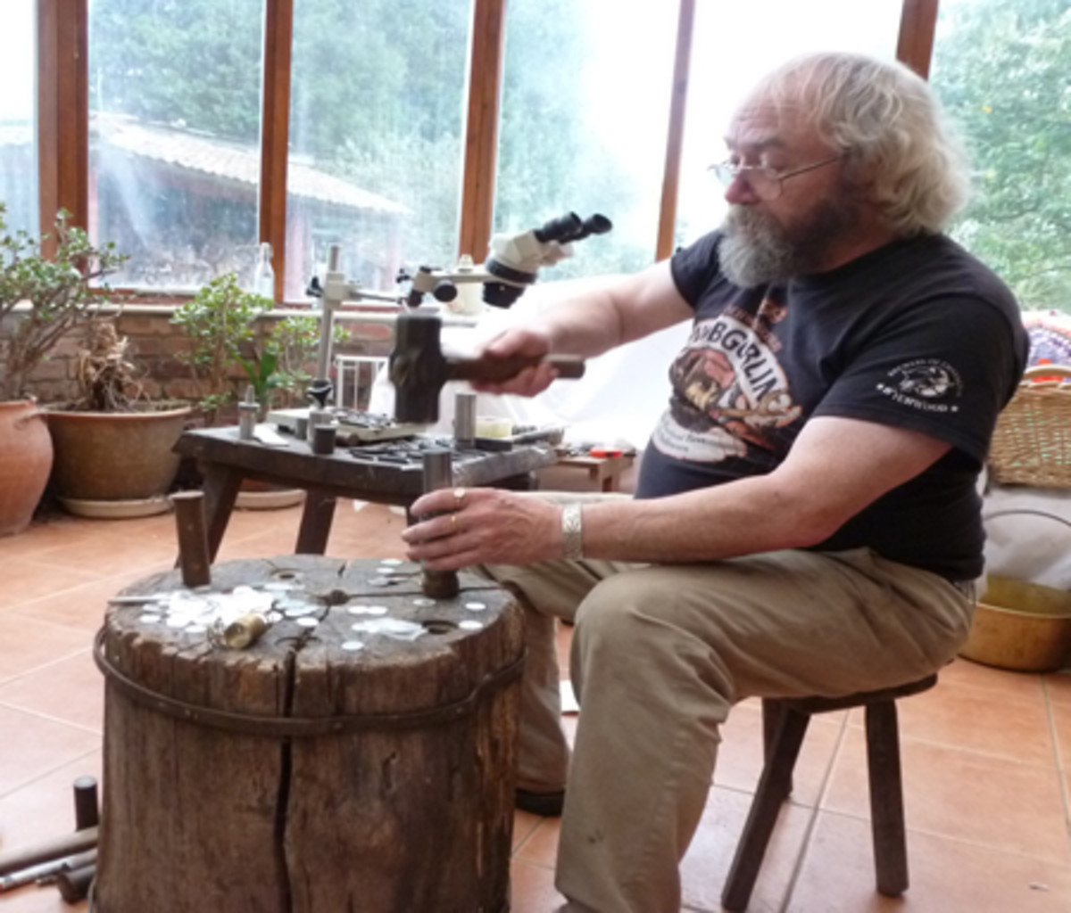 David Greenhalgh demonstrates how coins were struck in ancient times with hammer and anvil dies.