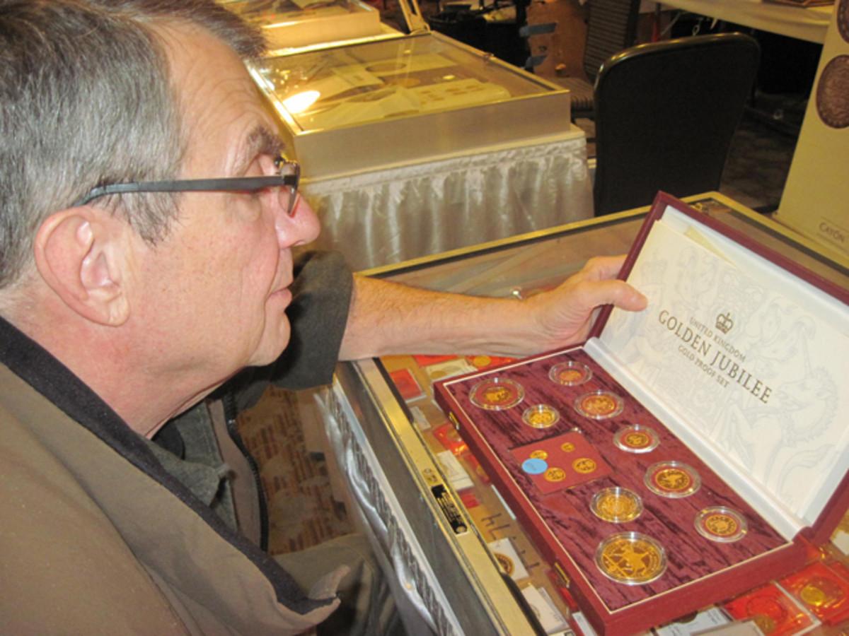 Bernie Gresik of Chicago looks over a 2002 Golden Jubilee gold proof set.