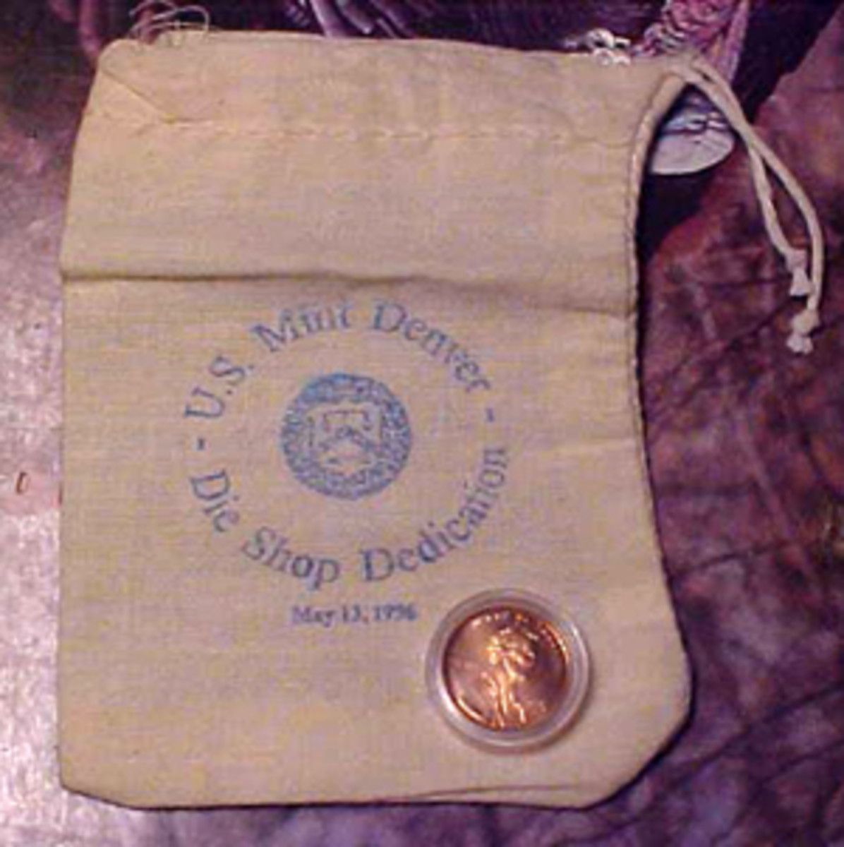 1996-D Lincoln cent and Denver Mint Pouch by Chuck Wishon Sr.