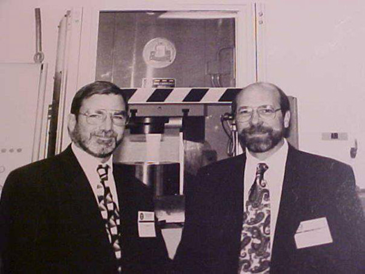 Stanton, left, and Wishon, right, pose here at the Denver Mint in a photograph taken by the American Numismatic Association.